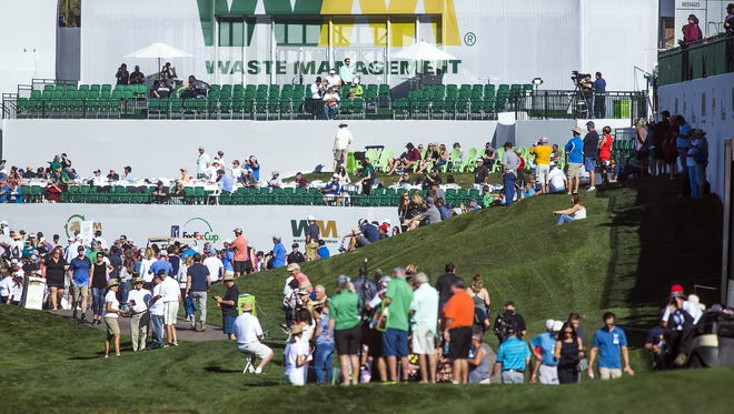 The crowd moves around the 18th green during the Annexus Pro-Am at the 2018 Waste Management Phoenix Open at TPC Scottsdale, Wednesday, January 31, 2018.