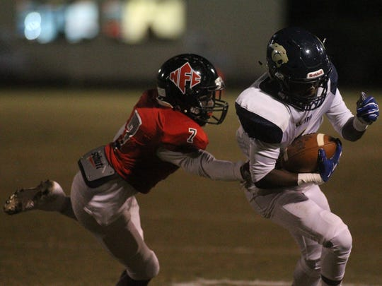 St. John Paul II's Will Evans tries to avoid an NFC
