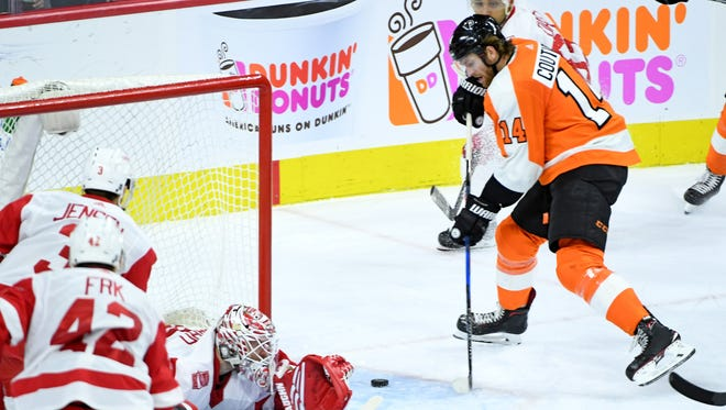 Sean Couturier (14) scores the game-winning goal past Detroit Red Wings goalie Jimmy Howard.