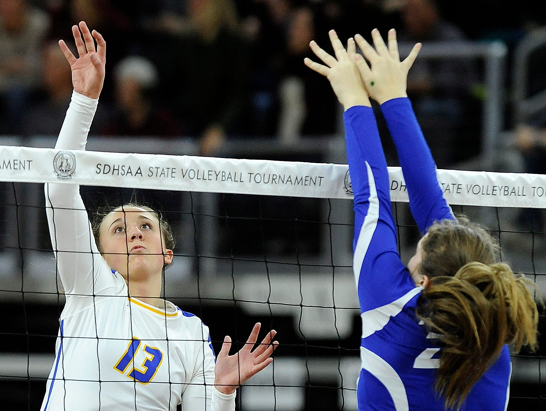 Aberdeen Central's #13 Brianna Kusler spikes the volleyball against O'Gorman's #20 Courtney Baruth during state semifinals volleyball action at the Denny Sanford Premier Center in Sioux Falls, S.D., Friday, Nov. 20, 2015.