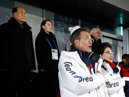 South Korean President Moon Jae-in, second from bottom right, stands alongside first lady Kim Jung-sook as the South Korean national anthem is played at the opening ceremony of the 2018 Winter Olympics in Pyeongchang, South Korea, Friday, Feb. 9, 2018. Standing at top left is Kim Yong Nam, president of the Presidium of North Korean Parliament, and Kim Yo Jong, sister of North Korean leader Kim Jong Un. (AP Photo/Patrick Semansky, Pool)