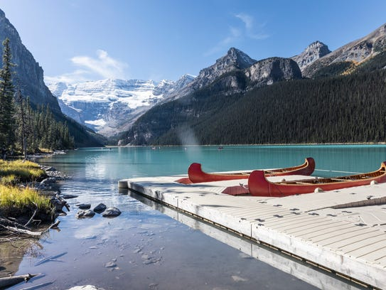 Canoes are at the ready on Lake Louise. A gentle paddle