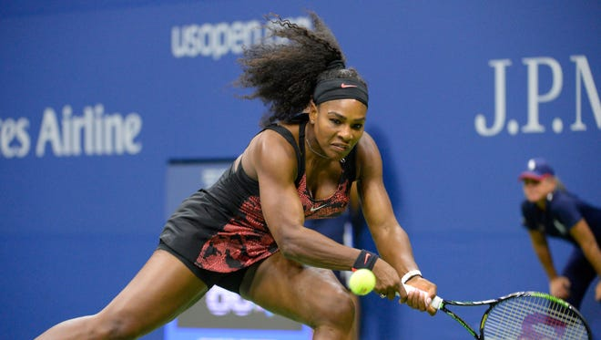 Serena Williams of the United States hits to Vitalia Diatchenko of Russia on day one of the 2015 US Open tennis tournament at USTA Billie Jean King National Tennis Center.