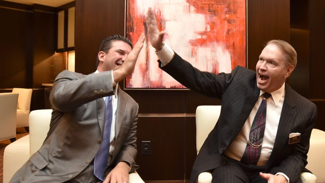 Anthony Marnell III, CEO of Marnell Casinos LLC (left), high fives Carlton Geer, CEO and Chairman of Global Gaming & Hospitality.
