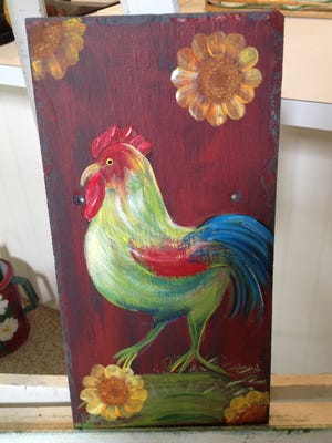 Rooster painted on slate roofing tile.