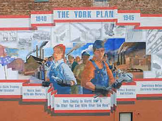 "This York Plan mural is on the north wall of the Bell Socialization Services building on South George Street.  This photo was taken when it was relatively new.  Today, it is fading and – in some places – the paint is flaking.  The words under the mural are The York Plan motto:  ""Do What You Can With What You Have."""