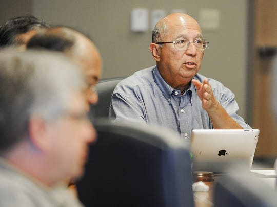 Consolidated Commission on Utilities Chairman Joseph Duenas expresses his concern for the safety of Guam Power Authority employees to GPA General Manager John Benavente during a meeting at the Gloria B. Nelson Public Service Building in Mangilao on Wednesday, Oct. 14.