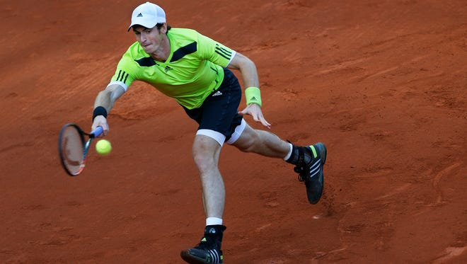 Britain's Andy Murray returns the ball during the quarterfinal match of the French Open tennis tournament against France's Gael Monfils at the Roland Garros stadium, in Paris, France, Wednesday, June 4, 2014.
