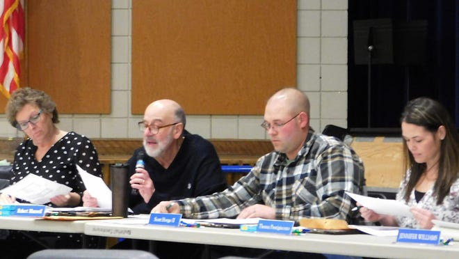The Dolgeville Board of Education moved Wednesday to eliminate several positions as part of an effort to close a $440,000 budget deficit.