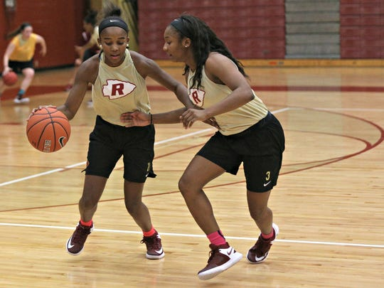 Riverdale's Aislynn Hayes, left, and Anastasia Hayes work on drills during Monday's first day of high school basketball practice.