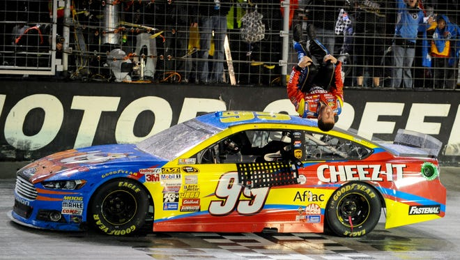 Carl Edwards does his signature backflip after winning the Food City 500 Sunday at Bristol Motor Speedway.