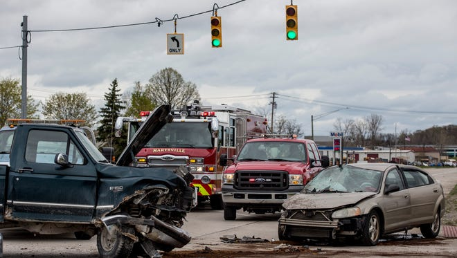 Marysville Police and Fire departments work the scene of an accident Tuesday, May 2, 2017 at Busha Highway and Michigan Avenue.