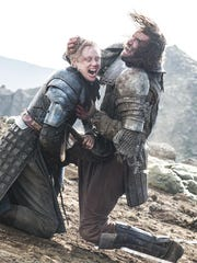Sandor 'The Hound' Clegane (Rory McCann), right, looked like a goner after this epic clash with Brienne of Tarth (Gwendoline Christie), but things are always what they appear to be on HBO's 'Game of Thrones.'