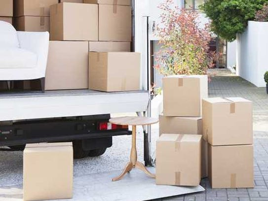 A moving van packed with boxes.