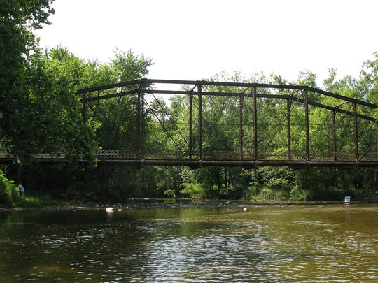 The truss bridge that has been disassembled and transported to Muncie for the Kitselman Trailhead and Park.