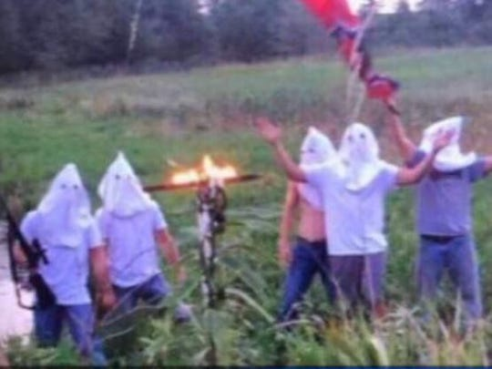 Creston Community High School officials say they learned Wednesday, Sept. 6, 2017, that Creston students were involved in this photo, which shows five people wearing white hoods, one waving what looks like a Confederate flag, and a burning cross nearby.