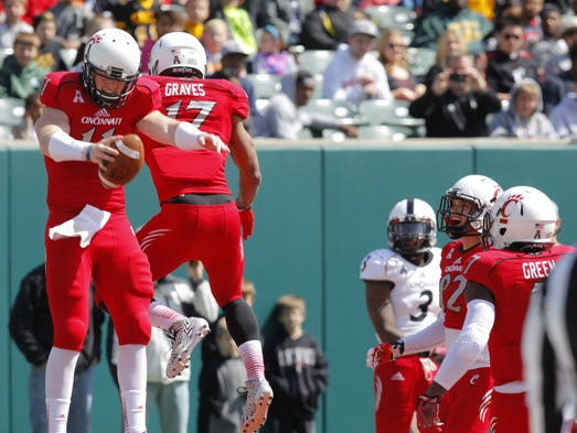 Gunner Kiel jump-bumps with Jeremy Graves after scoring during the Bearcats' spring game, which was held Saturday at Paul Brown Stadium.