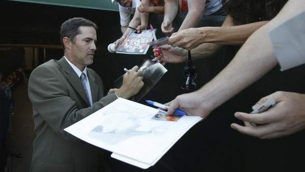 Mike Mussina signs autographs before the induction into the Rochester Red Wings Hall of Fame Saturday.