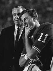Florida coach Ray Graves confers with quarterback Steve Spurrier at the 1967 Orange Bowl against Georgia Tech.  Spurrier won the Heisman Trophy for the 1966 season.