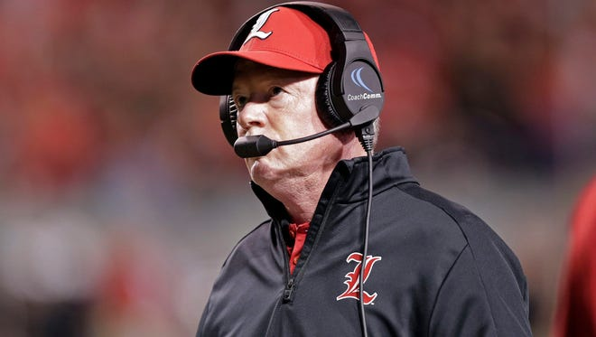 Louisville head coach Bobby Petrino watches during the first half of an NCAA college football game against North Carolina State in Raleigh, N.C., Thursday, Oct. 5, 2017. (AP Photo/Gerry Broome)