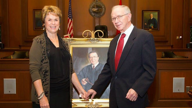 Former Sumner County Chancellor Tom E. Gray  and his wife, Janice, stand with a portrait of the former chancery court judge unveiled Friday, Jan. 13.