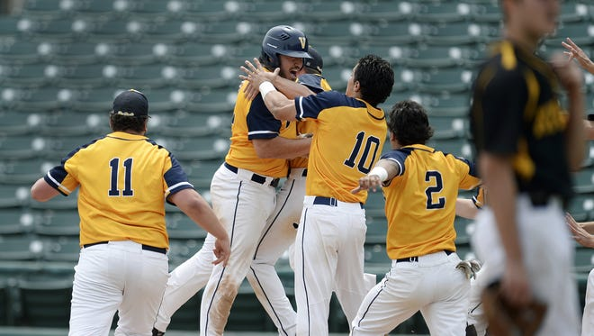 Victor players mob Chris Varone, facing, after his walk-off walk during the Section V Class AA championship game at Frontier Field, Saturday, May 26, 2018. No. 1 seed Victor won the Class AA title with a 3-2 win over No. 2 seed McQuaid.