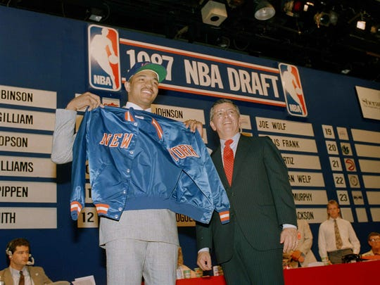 St. John's Mark Jackson, left, holding up a Knicks jacket as NBA Commissioner David Stern looks on after the Knicks selected Jackson at the NBA draft in New York, June 22, 1987.