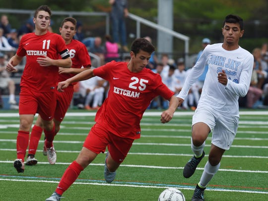 Ketcham's John Reitter, left, tries to swoop in and