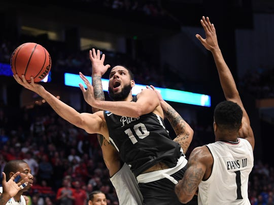Wolf Pack star Caleb Martin shoots against Cincinnati during their NCAA Tournament game last month.