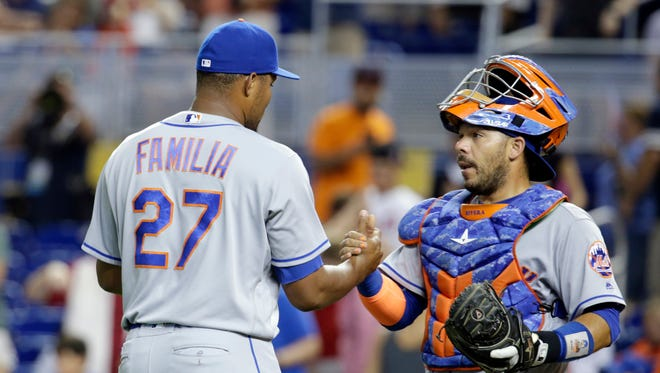 New York Mets relief pitcher Jeurys Familia (27) shakes hands with catcher Rene Rivera after the Mets defeated the Miami Marlins 3-0 in a baseball game, Sunday, July 24, 2016, in Miami. (AP Photo/Lynne Sladky)