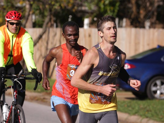 It was a sunny day for the Bass Pro Conservation Marathon Sunday, Nov. 6 2016. Near the races end, Shawn Etzenhouser (93) has a slight lead over Anthony Mugo. Shawn won the race.