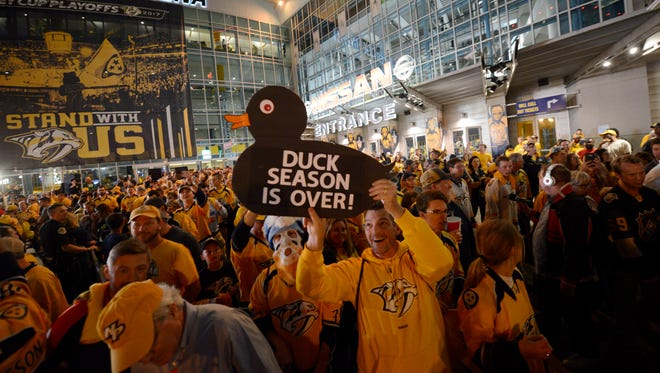 Predators fans celebrate outside after the 6-3 win over the Ducks in game 6 of the Western Conference finals at Bridgestone Arena Monday, May 22, 2017 in Nashville, Tenn.