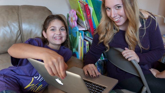 Samantha Buggle (center),11, Aberdeen, has epilepsy. She created a Facebook page that has a huge following in the epilepsy community and will hold a fundraiser for the Epilepsy Foundation on Oct. 17. She is with her friend Elizabeth Percy of Union Beach, who is helping with the fundraiser.
