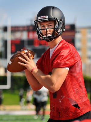 St. Cloud State quarterback Nate Meyer (8) gets ready to throw a pass during the first day of practice on August 13, 2014 at Husky Stadium.