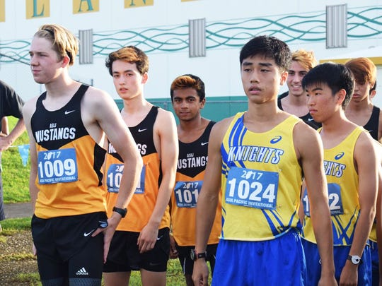 Runners get ready before the start of the API Cross Country Championships, held Friday Oct. 20,2017, at John F. Kennedy High School. The event continues Saturday at Ypao for the relay title.