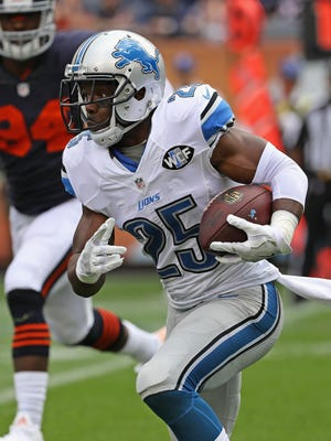Lions RB Theo Riddick runs against the Chicago Bears at Soldier Field on Oct. 2, 2016 in Chicago.