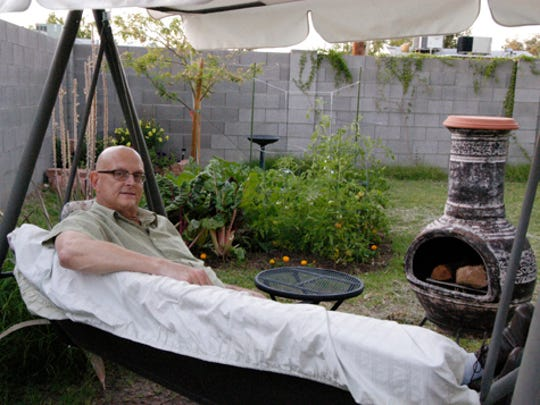 Doug is pictured in their backyard in 2010 after a round of chemotherapy. Laura always believed he would get better.