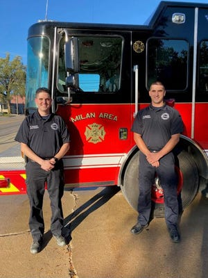 Kyle Maury, left, and his brother Kevin Maury, both promoted to ieutenant status, in front of a fire truck at the Milan Area Fire Department in Milan.