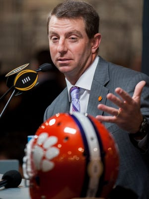 Clemson coach Dabo Swinney talks with reporters during the National Championship Media Day on Saturday January 9, 2016 at the Convention Center in Phoenix, Az. The championship game will be held on Monday January 11.