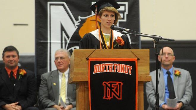 North Fond du Lac High School valedictorian Shelby Demboski speaks Sunday during the school's graduation ceremony.