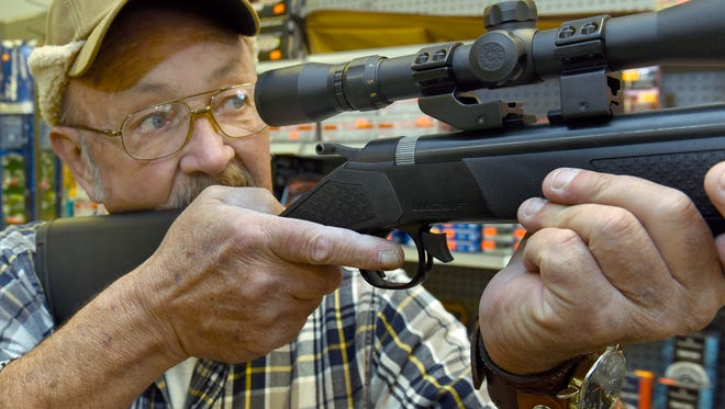 Shawn Orr checks the scope on a rifle at Sportsman Deals, 1607 Orchard Drive, Tuesday, November 11, 2016. The Chambersburg store does not sell firearms but they sell scopes and perform bore sighting. Rifle deer hunting season starts on Monday.