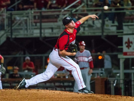 UL's Colten Schmidt throws a pitch to the batter as