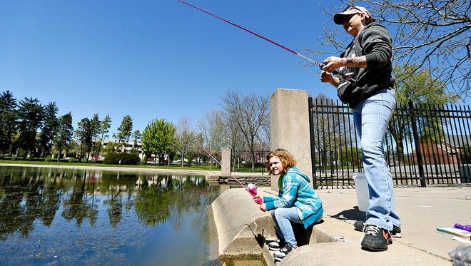 Crystal Myers, right, fishes with her granddaughter Cassidy Myers, 5, at Kiwanis Lake in York City, Wednesday, April 20, 2016. Dawn J. Sagert photo