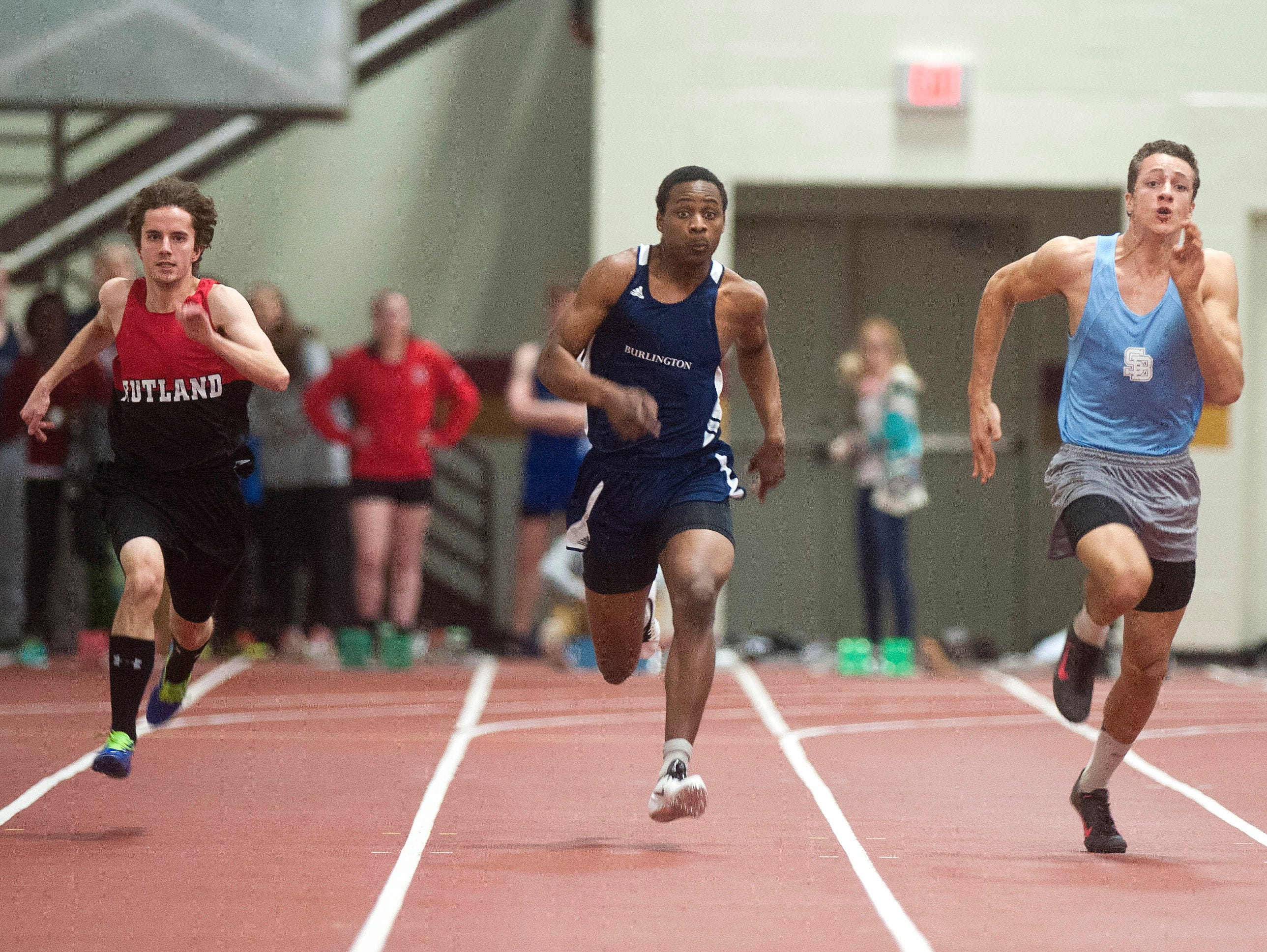 South Burlington's Caleb Kasupski, right, races alongside Burlington's Ahmed Noor, Rutland's Ben Lane, second from left, and Champlain Valley's Tawn Tomasi en route to winning the Division I boys 55-meter dash on Saturday at Norwich University.