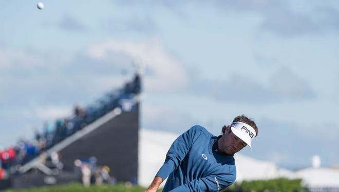 Jul 14, 2016; Troon,Ayrshire, SCT;  Bubba Watson (USA) plays from the rough at the first during the first round round of the 145th Open Championship golf tournament at Royal Troon Golf Club - Old Course. Mandatory Credit: Ian Rutherford-USA TODAY Sports