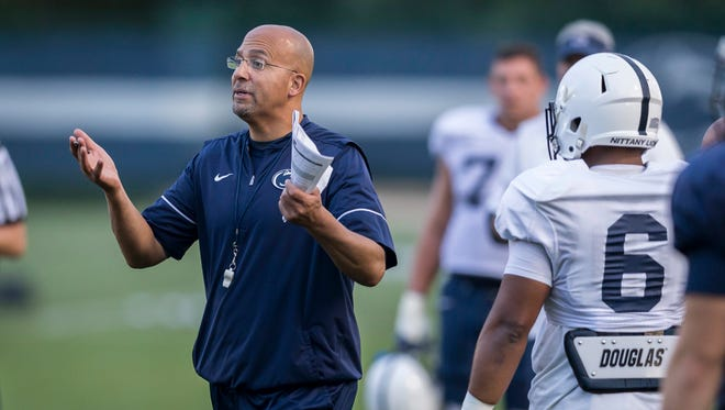 Penn State coach James Franklin talks to the team during practice Wednesday, Sept. 13, 2017, in State College, Pa. Franklin says he likes what he sees from some of his team's redshirt freshmen.