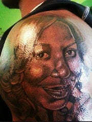 Johnson surprised his mother with this portrait tattoo