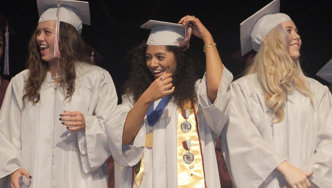 Station Camp High School graduates turn their tassels at commencement exercises in Hendersonville , TN on Friday MAy 18, 2018.