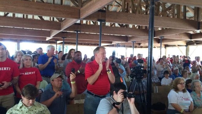 The Neshoba County Fair crowd gives a standing ovation to former Gov. William Winter, who spoke Thursday at this event for the 26th time in his political career.