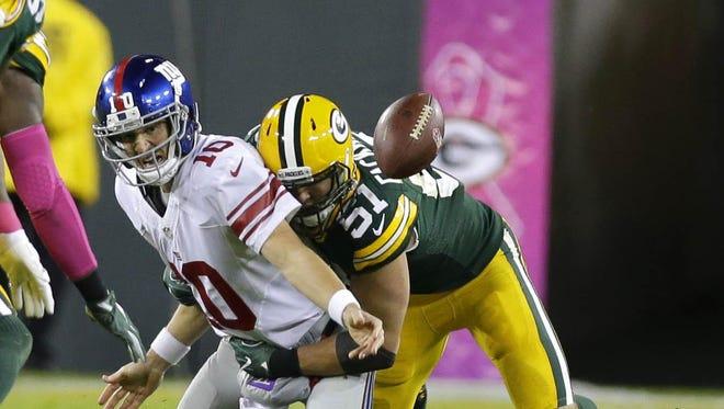 Green Bay Packers outside linebacker Kyler Fackrell (51) sacks New York Giants quarterback Eli Manning (10) during the first half at Lambeau Field on Oct. 9.